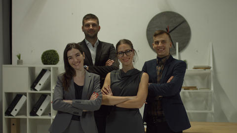 Portrait of smiling business people at the office GIF