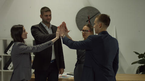 Successful business team joining hands together Live Action