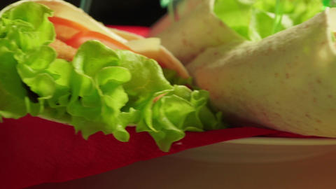 Close up dolly shot of pile of Caesar rolls with chicken, tomatoes and lettuce Footage