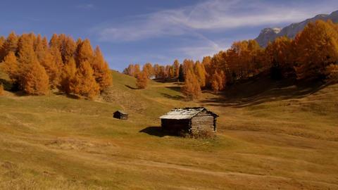 tracking shot barns in autumn Alta Badia, Dolomites Footage