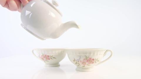 Tea being poured into two teacups Live Action