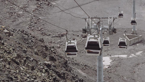 Funitel lift cabins rides on cables in stony mountains Footage