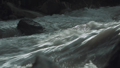 Raging mountain river stony rapids water flow with white splashes Footage