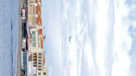 Vertical video. Plane over the coast. Ostia, Rome, Italy Footage