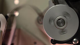 Rotating spool in professional film cinema projector, 4K video, part of set Live Action