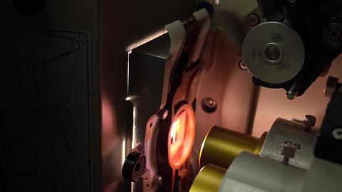 Close up dolly shot of pro film cinema projector details, 4K, part of set Footage