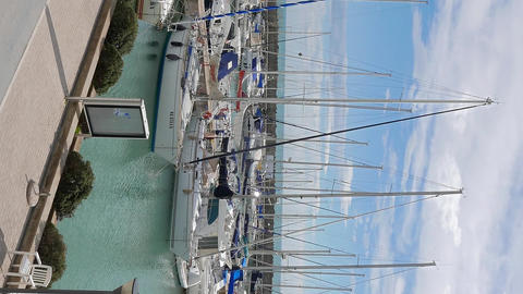 Vertical video. Yachts in the port of Ostia, Italy ビデオ