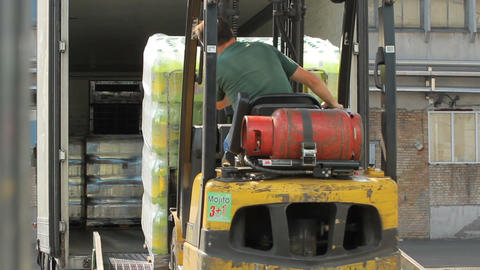 Forklift truck loading a truck Footage