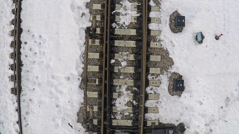 Rails and sleepers in snow. Aerial shot GIF