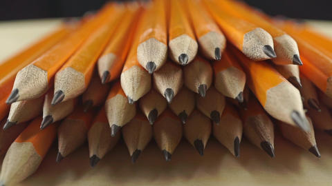 Heap of bright pencils, close up dolly shot Footage