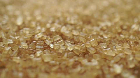 Heap of granulated brown sugar macro dolly shot, shallow focus Live Action