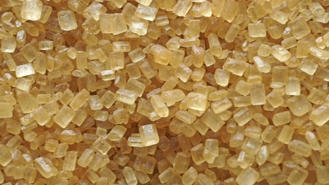 Pile of granulated brown sugar macro dolly shot, view from above Live Action
