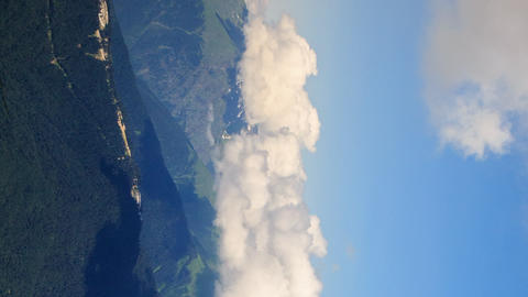 Vertical video. Clouds in the mountains. Time Lapse. Krasnaya Polyana, Sochi, Footage