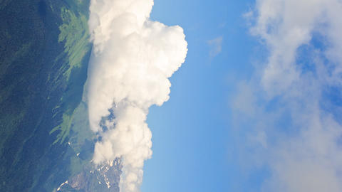 Vertical video. Clouds in the mountains. Zoom. TimeLapse. Rosa Khutor. Sochi, Footage