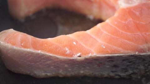 Frying salmon steak on anti-stick frying pan. Macro dolly video Live Action