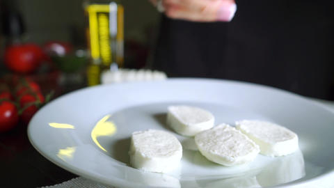 Putting mozzarella slices on the plate, cooking Caprese salad. Part of the set Footage