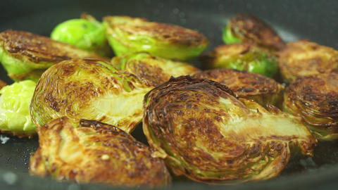 Frying Brussels sprouts macro shot Footage