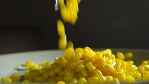 Pouring sweet corn out of the can, slow motion video Footage
