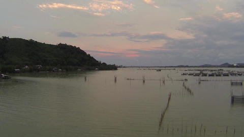 Aerial sunset video of fishing nets on the lake Footage