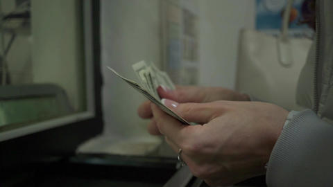 Young woman exchanging dollars at exchange point of the bank Footage