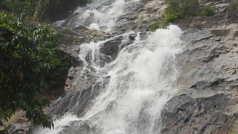 Slow motion video of tropical waterfall and rocks Footage