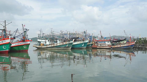 Songkhla (Thailand) pier and moored old fishing vessels. Slow motion video Footage