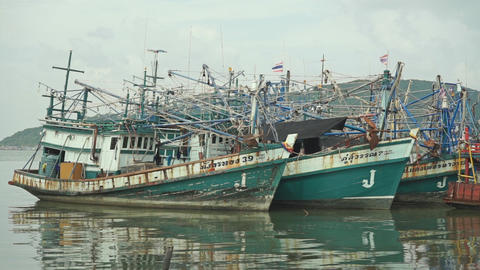 Songkhla (Thailand) pier and moored fishing boats. Slow motion video Footage