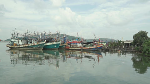 Parked old fishing boats near fishermen village Footage