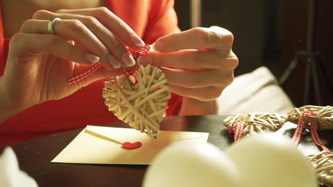 Beautiful girl making a romantic present for Valentine's day Footage