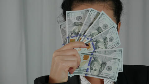 Cute Business Woman Displaying a Spread of Cash Footage