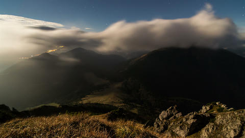 Fast moving night clouds in mountain time lapse Footage