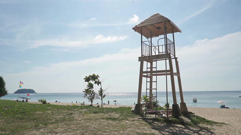 Phuket beach rescue tower and Thai flag Footage