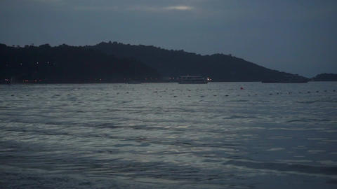 Patong beach surf in the evening, slow motion video. Phuket, Thailand Footage
