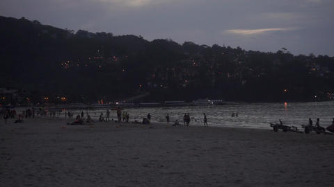 Phuket Patong beach in the evening with silhouettes of people Footage