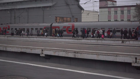 People boarding suburban train at Moscow railway station Footage