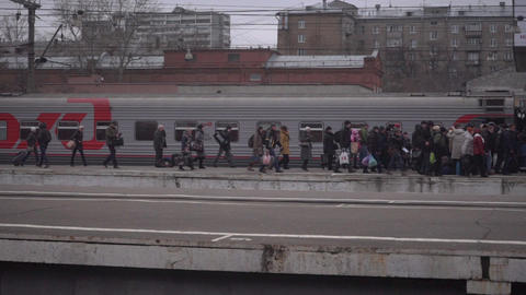 People entering car of suburban train at Moscow railway station Footage