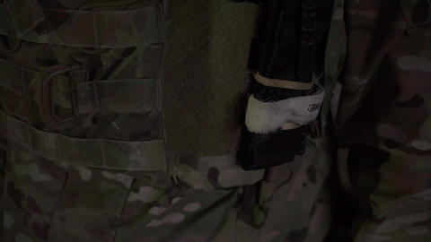 Closeup shot of a soldier with USA flag tab on a bulletproof vest Footage