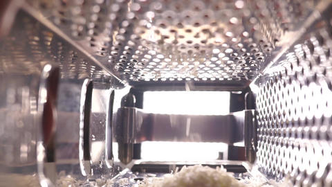 Grating cheese with metal grater Footage