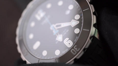 Setting time and date of a swiss made wrist watch Footage