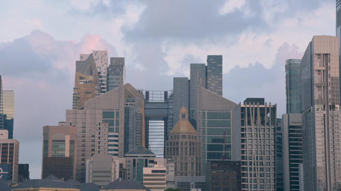 Singapore city buildings and moving clouds at sunset Footage
