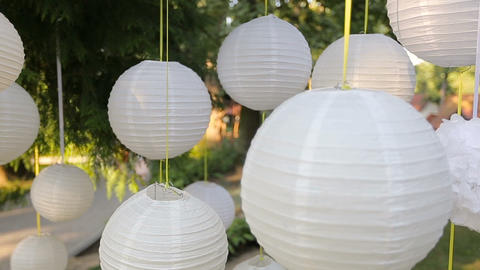 Closeup Beautiful decor for a party of white paper Chinese lanterns hanging in a Live Action