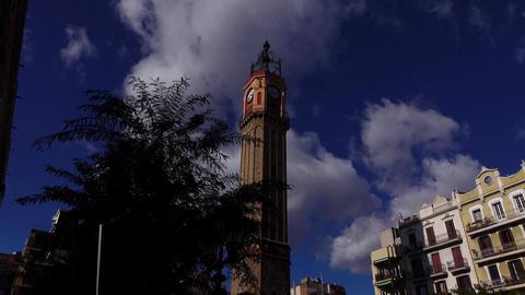 Torre del rellotge, clock tower at central square of Vila de Gracia, Grace Bell Footage