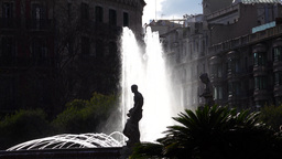 Placa Catalunya fountain and sculpture silhouette, high contrast shot, back lit Live Action