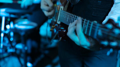 Man playing a guitar at a rock concert. Guitar close up. guitarist playing at a  Footage