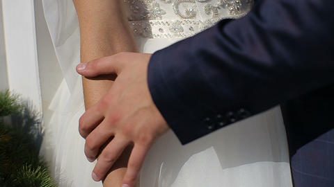 Couple standing gently caress each other's hands Footage