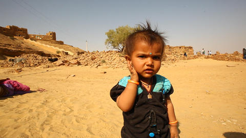 Poor child in sand desert Rajasthan India Footage