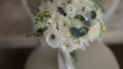 Beautiful wedding bouquet on a vintage chair Footage