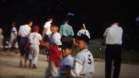 1964: Little league baseball boys team yankees leaving field Footage