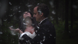 Happy Bridal And Groom Playing With Feathers Footage