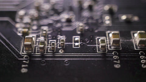 Black computer circuit board macro dolly shot Live Action